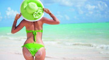 beautiful young woman in sexy bikini at the beach